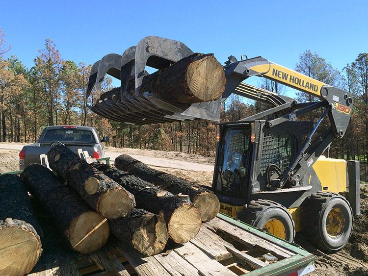 loading-burned-trees-onto-trailer